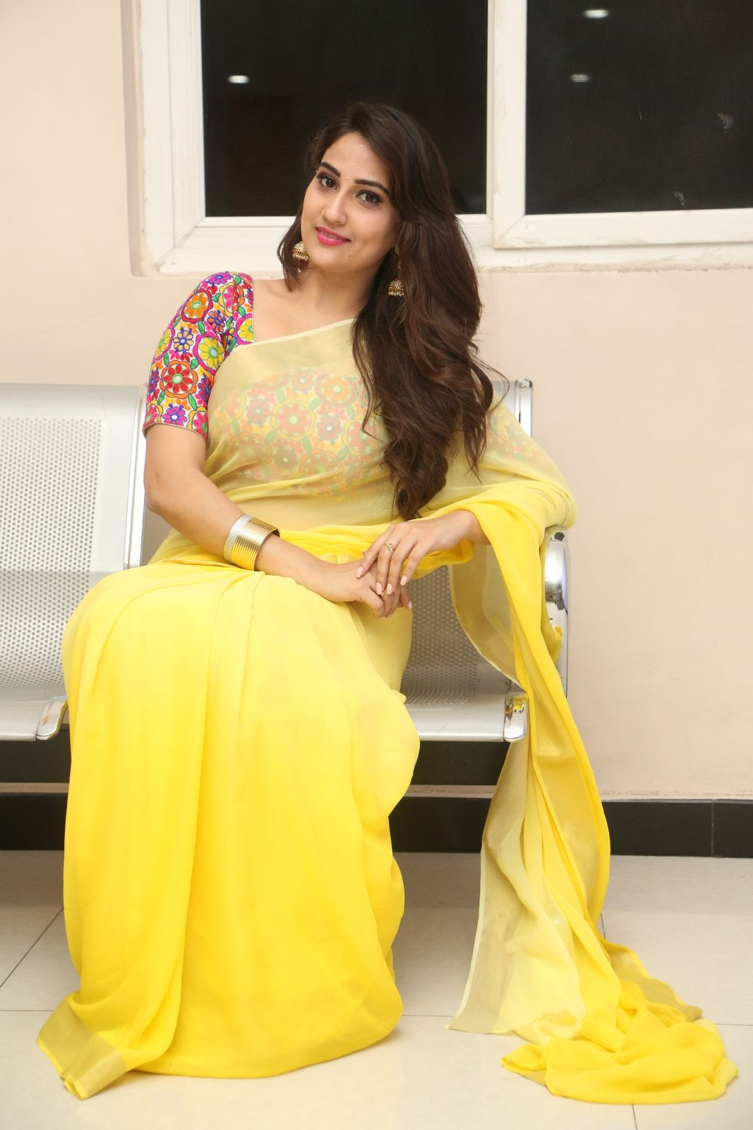 Anchor Manjusha in Yellow Saree Photo